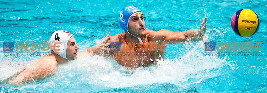 Eindhoven , Netherlands (NED) 16/1/2012.LEN European  Water Polo Championships 2012.Day 01 - Men.HUN (White) - ITA (Blue)..HUN.1.BAKSA Laszlo Zsolt..2.BIROS Peter..3.HARAI Balazs..4.HOSNYANSZKY Norbert..5.KASAS Tamas Zoltan..6.KA TONAS.Gergo..7.KISS Gergely..8.MADARAS Norbert..9.STEINMETZ Adam..10.SZECSI Zoltan..11.SZIVOS Istvan Marton..12.VARGA Daniel Rudolf..13.VARGA Denes Andor..ITA.1.P ASTORINO.Giacomo..2.PEREZ Amaurys..3.GITTO Niccolo?..4.FIGLIOLI Pietro..5.GIORGETTI Alex..6.FELUGO Maurizio..7.FIGARI Niccolo?..8.GALLO Valentino..9.PRESCIUTTI Christian..10.FIORENTINI Deni..11.AICARDI Matteo..12.LAPENNA Federico..13.VOLAREVIC Goran.Photo Giorgio Scala / Insidefoto