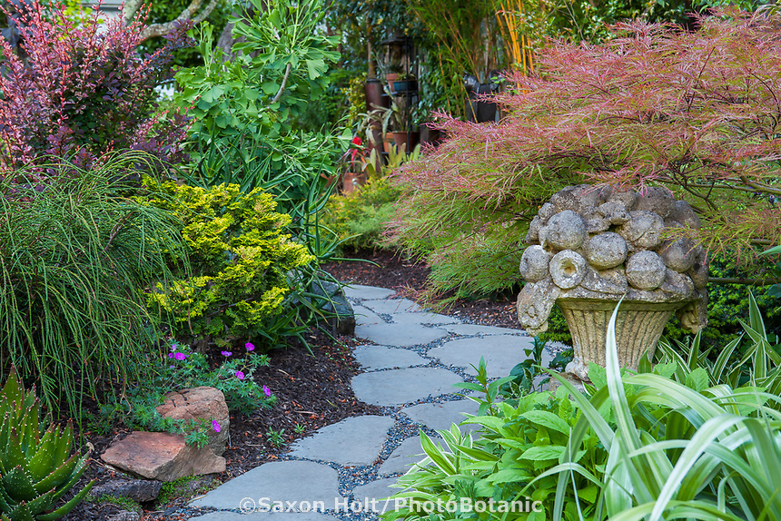 Stepping stone path through California plant collector garden with cast cement focal point garden art - Carol Brant