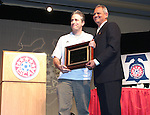 "Jon Stewart (l), host of Comedy Central's ""The Daily Show"" is awarded the NSCAA's Honorary All-America for 2005 by NSCAA president and Southern Methodist University soccer coach Schellas Hyndman (r) on Saturday, January 21st, 2006, during the National Soccer Coaches Association of America's annual convention in the Grand Ballroom of the Pennsylvania Convention Center in Philadelphia, PA."