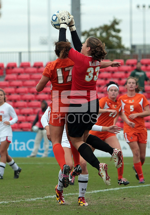 COLLEGE PARK, MD - OCTOBER 28, 2012:  Rachelle Beanlands (33) of the University of Maryland saves from Kim Hutchinson (17)  of Miami during an ACC  women's tournament 1st. round match at Ludwig Field in College Park, MD. on October 28. Maryland won 2-1 on a golden goal in extra time.