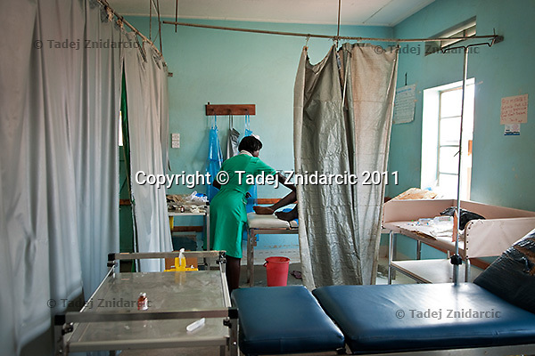 Nurse attends to a woman in labor in the delivery room of the labor ward of Arua Hospital, Uganda.