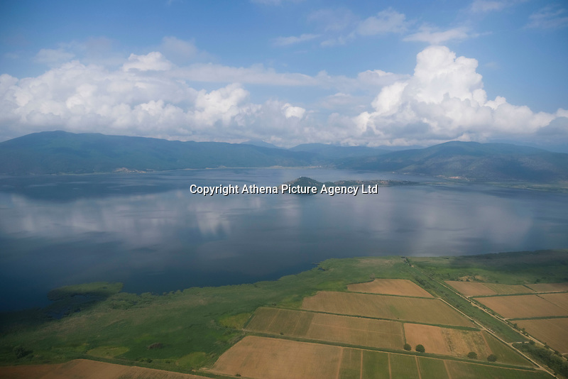 Pictured: Prespa Lake in northern Greece. Sunday 17 June 2018<br /> Re: Greece and the Former Yugoslav Republic Of Macedonia (FYROM) have signed a deal that aims to settle a decades-long dispute over the country's name.<br /> Under the agreement, Greece's neighbour will be known as North Macedonia.<br /> Heated rows over Macedonia's name have been going on since the break-up of the former Yugoslavia, of which it was a part, and have held up Macedonia's entry to Nato and the EU.<br /> Greece has long argued that by using the name Macedonia, its neighbour was implying it had a claim on the northern Greek province also called Macedonia.<br /> The two countries' leaders, Mr Tsipras and his Macedonian counterpart Zoran Zaev announced the deal on Tuesday and have pressed ahead despite protests.<br /> The two countries' foreign ministers signed the deal on Lake Prespa on Greece's northern border on Sunday.<br /> The agreement still needs to be approved by both parliaments and by a referendum in Macedonia.