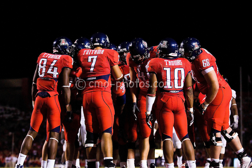 Oct 18, 2008; Tucson, AZ, USA; Arizona Wildcats quarterback Willie Tuitama (7) calls a play in an offensive huddle during a game against the California Golden Bears.  Arizona  defeated California 42-27 at Arizona Stadium.