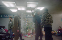 ROMANIA, In the subway, Bucharest, 31.12.1989.After Ceausescu's fall, volunters halp the army for controles in the subway. Many people stand there for celebreting the new year..© Andrei Pandele / EST&OST