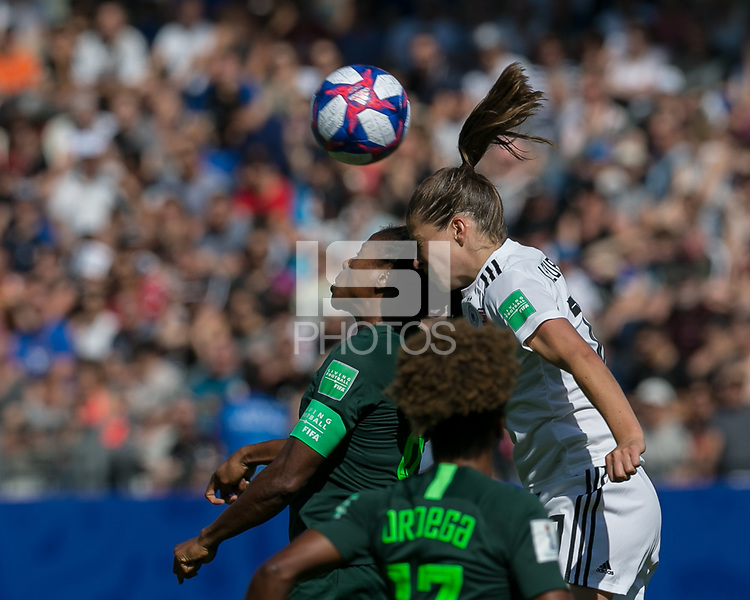 GRENOBLE, FRANCE - JUNE 22: Desire Oparanozie #9 of the Nigerian National Team, Melanie Leupolz #18 of the German National Team battle for head ball during a game between Nigeria and Germany at Stade des Alpes on June 22, 2019 in Grenoble, France.