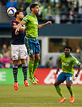 Seattle Sounders Leo Gonzales (12) and New England Revolution Kevin Alston (30) go for the ball during an MLS match on March 8, 2015 in Seattle, Washington.  The Sounders beat the Revolution 3-0.  Jim Bryant Photo. ©2015. All Rights Reserved.
