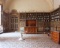 Tall double doors open into the 18th century pharmacy in the old hospital in Carpentras, one of the finest baroque buidings in Provence