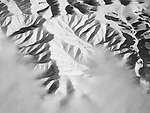 Snow-covered aerial mountain landscape over western Idaho.