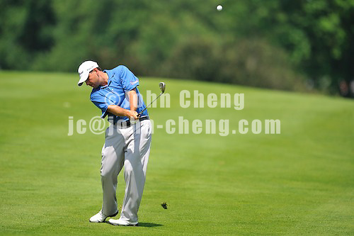 6/28/09 - Photo by John Cheng for Newsport.  Final round of 2009 Travelers Championship takes place at TPC River Highlands in Cromewll, Connecticut.  Ben Curtis hits from the fairway at the par 4 2nd hole.