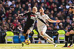 Ruben Miguel Nunes Vezo (l) of Granada CF battles for the ball with Karim Benzema of Real Madrid during their La Liga match between Real Madrid and Granada CF at the Santiago Bernabeu Stadium on 07 January 2017 in Madrid, Spain. Photo by Diego Gonzalez Souto / Power Sport Images