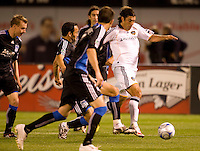 18 April 2009: Jovan Kirovski of the Galaxy dribbles the ball away from Ramiro Corrales of the Earthquakes during the game at Oakland-Alameda County Coliseum in Oakland, California.   Earthquakes and Galaxy are tied 1-1.