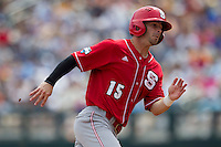 North Carolina State outfielder Bryan Adametz (15) rounds third base headed home during Game 3 of the 2013 Men's College World Series between the North Carolina State Wolfpack and North Carolina Tar Heels at TD Ameritrade Park on June 16, 2013 in Omaha, Nebraska. The Wolfpack defeated the Tar Heels 8-1. (Andrew Woolley/Four Seam Images)