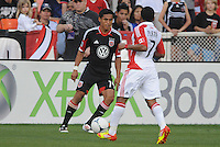 D.C. United Andy Najar (14) goes against Toronto FC forward Joao Plata (7) D.C. United defeated Toronto FC 3-1 at RFK Stadium, Saturday May 19, 2012.