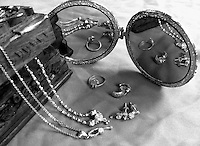 """Traditional Indian jewellery box and double reflections of ornaments in round mirrors black and white fine art still life stock image.<br /> <br /> To view the same image in color visit the gallery-""""Food & Other Still Life""""."""
