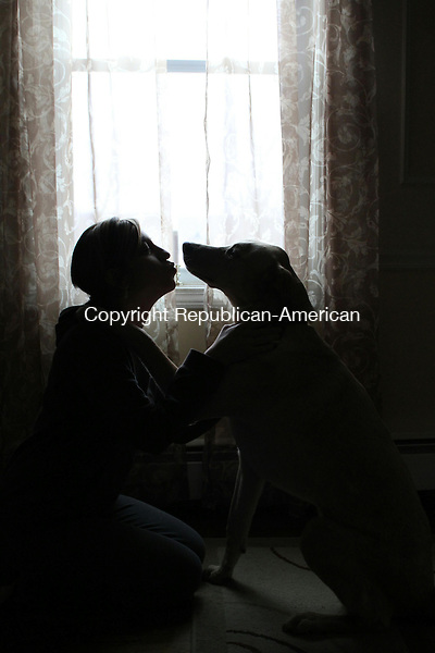 WATERBURY, CT-26 December 2013-122613LW03 - Carol Coffey gives a kiss to her dog, Max, in their Waterbury home. Max went missing for two weeks in August after he was hit by a car, but was reunited with his family. <br />