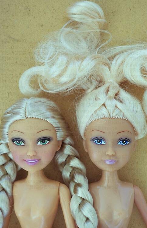 Contemporary woman dolls with stereotypical big eyes long blonde hair