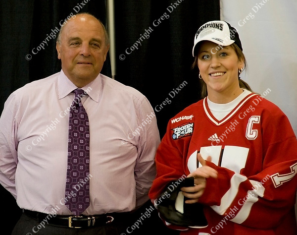 Patty Kazmaier Award winner, Meghan Duggan, stands with Wisconsin athletic director, Barry Alvarez, at the event to celebrate the UW women's hockey team's NCAA championship at the Nicholas Johnson Pavilion on Monday, 3/21/11, in Madison, Wisconsin | Photos by Greg Dixon accompanied Andy Baggot article in the Wisconsin State Journal and madison.com at http://j.mp/h1sUOJ