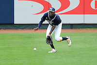 17 April 2010:  FIU's Jabari Henry (14) fields a ball in left field in the sixth inning as the FIU Golden Panthers defeated the University of New Orleans Privateers, 6-4, at University Park Stadium in Miami, Florida.