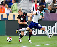 Amy Rodriguez (8) of the USWNT fights for the ball with Saki Kumagai (4) of Japan during the game at WakeMed Soccer Park in Cary, NC.   The USWNT defeated Japan, 2-0.