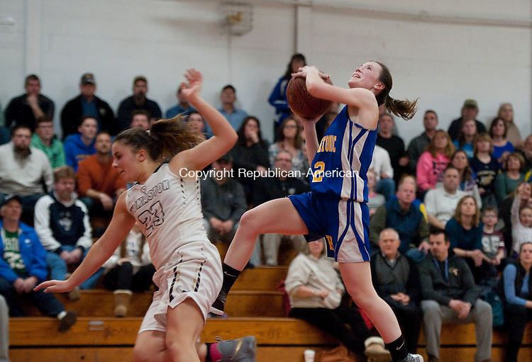 LITCHFIELD, CT-022217JS15---Housatonic's Chloe Dakers was able to get her shot off despite being fouled by Thomaston's Christina Winburn during their Berkshire League tournament finals game Wednesday at Wamogo High School in Litchfield. <br /> Jim Shannon Republican-American