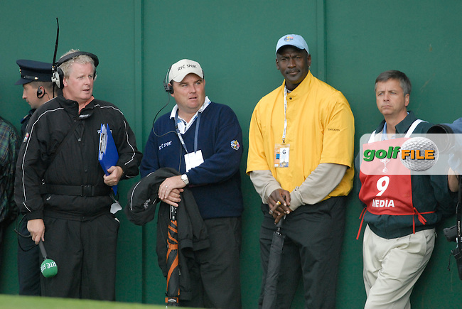 23rd September, 2006. Former American basketball player Michael Jordan (yellow jumper) watches play on the 9th hole during the afternoon fourball session of the second day of the 2006 Ryder Cup at the K Club in Straffan, County Kildare in the Republic of Ireland..Photo: Eoin Clarke/ Newsfile.