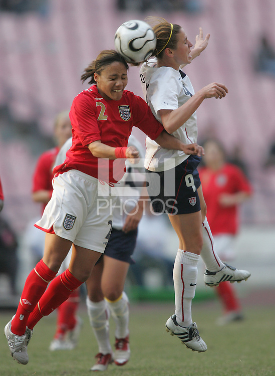 January 28, 2007:  USWNT forward (9) Heather O'Reilly goes up for a header against England's (2) Alexandra Scott during the Four Nations Tournament held at Guangdong Olympic Stadium in Guanzhou, China.  The USWNT tied England, 1-1.