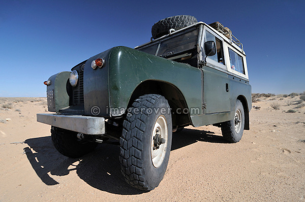 Africa, Tunisia, nr. Douz. Land Rover Series 2a on Michelin XS sand tyres in the desert.  --- No releases available, but releases may not be needed for certain uses. Automotive trademarks are the property of the trademark holder, authorization may be needed for some uses.
