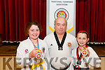 Tae K Won-Do Winners: Ava Barrett, Liselton, Bronze Medal,  & Megan Lynch, Killocrim, Gold Medal pictured with their instructor Tim Madigan after their success in the recent championships in Glasgow.