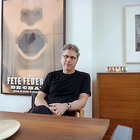 Portrait of architect James Biber in the dining room of his Brooklyn home