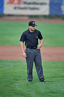 Umpire Ethan McCranie handles the calls on the bases during a game between the Ogden Raptors and the Great Falls Voyagers at Lindquist Field on August 21, 2018 in Ogden, Utah. Great Falls defeated Ogden 14-5. (Stephen Smith/Four Seam Images)