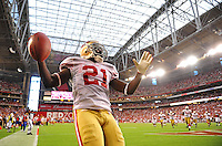 Sept. 13, 2009; Glendale, AZ, USA; San Francisco 49ers running back (21) Frank Gore celebrates his fourth quarter touchdown against the Arizona Cardinals at University of Phoenix Stadium. San Francisco defeated Arizona 20-16. Mandatory Credit: Mark J. Rebilas-
