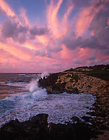 Waves Crashing against Makawehi Bluff at Sunset, Poipu, Kauai, Hawaii, USA.