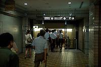 Underground landscape view of people walking to the Kamiyacho Eki following the 311 Tohoku Tsunami in Tokyo, Japan  © LAN