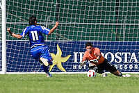 Fernando Pina (1) of the United States makes a save on Ivan Castro (11) of El Salvador during the quarterfinals of the CONCACAF Men's Under 17 Championship at Catherine Hall Stadium in Montego Bay, Jamaica. The USA defeated El Salvador, 3-2, in overtime.