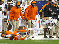 Charlotte, NC - December 2, 2017: Miami Hurricanes wide receiver Braxton Berrios (8) gets tackled during the ACC championship game between Miami and Clemson at Bank of America Stadium in Charlotte, NC.  (Photo by Elliott Brown/Media Images International) Clemson defeated Miami 38-3 for their third consecutive championship title.