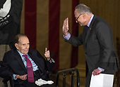 United States Senate Minority Leader Chuck Schumer (Democrat of New York), right, waves to US President Donald J. Trump as former US Senator Bob Dole (Republican of Kansas) signals his approval at a Congressional Gold Medal ceremony honoring Dole in the Rotunda of the US Capitol on Wednesday, January 17, 2017.  Congress commissioned gold medals as its highest expression of national appreciation for distinguished achievements and contributions.  Dole served in Congress from 1961 through 1996, was the Senate GOP leader from 1985 through 1996, and was the 1996 Republican Party nominee for President of the United States.<br /> Credit: Ron Sachs / CNP