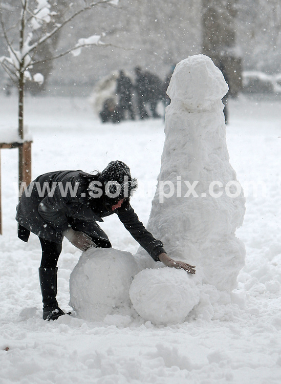 **ALL ROUND PICTURES FROM SOLARPIX.COM**.**NO UK NEWSPAPER PUBLICATION**.**UK MAGAZINE & SUPPLEMENT PUBLICATION ONLY** AND NO PUBLICATION IN AUSTRALIA, FRANCE, GERMANY AND SCANDINAVIA** .A woman works on a penis shaped snowman in St James park in central London this afternoon, as heavy snow forced many Londoners to have the day off as buses were cancelled and roads became blocked by accidents. London, UK. 2 February 2009..This pic: Phallic snowman..JOB REF: 8388 SFE       DATE: 02_02_2009.**MUST CREDIT SOLARPIX.COM OR DOUBLE FEE WILL BE CHARGED* *ONLINE USAGE FEE £50.00 PER PICTURE - NOTIFICATION OF USAGE TO PHOTO@SOLARPIX.COM*