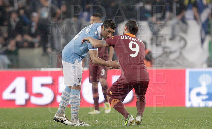 Calcio, Serie A: Lazio vs Roma. Roma, stadio Olimpico, 11 novembre 2012..Lazio defender Andre Dias, of Brazil, left, comforts AS Roma forward Pablo Daniel Osvaldo at the end of the Italian Serie A football match between Lazio and AS Roma, at Rome's Olympic stadium, 11 November 2012. Lazio won 3-2..UPDATE IMAGES PRESS/Riccardo De Luca