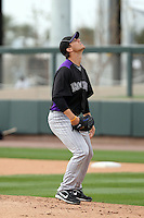 Christian Friedrich of the Colorado Rockies participates in spring training workouts at Salt River Fields on February 26, 2011  in Scottsdale, Arizona. .Photo by:  Bill Mitchell/Four Seam Images.