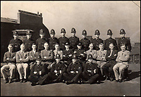 BNPS.co.uk (01202 558833)<br /> Pic: JoePinguey/BNPS.<br /> <br /> Pulfrey (back row 3rd left) was a Sheffield policeman before the war.<br /> <br /> The tragic tale of downed RAF Lancaster bomb aimer and the heartwarming friendship which developed between the farmer who found his body and his grieving family can be told after his medals emerged for sale.<br /> <br /> Flying Officer Leslie Pulfrey, of 103 Sqn RAF Bomber Command was killed when his Lancaster was shot down by a Luftwaffe fighter over the Netherlands on the way back from a raid on a German oil refinery.<br /> <br /> His body was found on 16th June 1944 by a Dutch farmer Gerrit Van Eerden wrapped in an unopened parachute and with bullet wounds to his neck.<br /> <br /> Only one of the crew survived the crash and Pulfrey was laid to rest with five of his comrades in the local cemetery.<br /> <br /> Fly Off Pulfrey's nephew Joe Pinguey, 67, a retired motor mechanic from Penistone, south Yorkshire, is putting his medals on the market with Sheffield Auction Gallery for &pound;1,200.