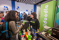 A visitor speaks with a Solidoodle employee at the TechDay New York event on Thursday, April 23, 2015. Thousands attended to seek jobs with the startups and to network with their peers. TechDay bills itself as the world's largest startup event with over 300 exhibitors. (© Richard B. Levine)