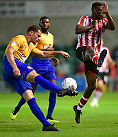 Mansfield Town's Matt Preston under pressure from Lincoln City's Bernard Mensah<br /> <br /> Photographer Chris Vaughan/CameraSport<br /> <br /> The EFL Checkatrade Trophy Group H - Lincoln City v Mansfield Town - Tuesday September 4th 2018 - Sincil Bank - Lincoln<br />  <br /> World Copyright © 2018 CameraSport. All rights reserved. 43 Linden Ave. Countesthorpe. Leicester. England. LE8 5PG - Tel: +44 (0) 116 277 4147 - admin@camerasport.com - www.camerasport.com