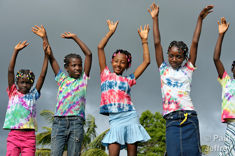 "Members of Nouvel Etwal - Haitian Kreyol for ""New Stars"" - dance on a hillside in Mizak, Haiti. Nouvel Etwal is a dance and creative movement group of 16 girls from age 8 to 13, based in the southern village of Mizak. According to Valerie Mossman-Celestin, an organizer of the group, ""Nouvel Etwal seeks to empowers girls to be self-confident and creative. The girls learn flexibility, discipline and teamwork, lessons they also need for life. Nouvel Etwal promotes health, well-being and enhanced self-worth. The girls are encouraged to live into a brighter future where girls and women are valued,  educated, and have equal opportunity to achieve their potential."""