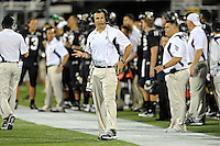 25 October 2011:  FIU Football Head Coach Mario Cristobal discusses strategy with his assistants during the third quarter as the FIU Golden Panthers defeated the Troy University Trojans, 23-20 in overtime, at FIU Stadium in Miami, Florida.