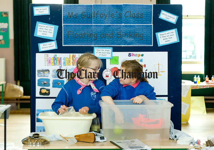 Joanna Lacka and Rose Guy hard at work on their project during Science Week at the Holy Family School in Ennis. Photograph by Declan Monaghan