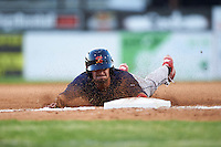 State College Spikes designated hitter Josh Swirchak (26) slides head first into third during a game against the Batavia Muckdogs on June 24, 2016 at Dwyer Stadium in Batavia, New York.  State College defeated Batavia 10-3.  (Mike Janes/Four Seam Images)