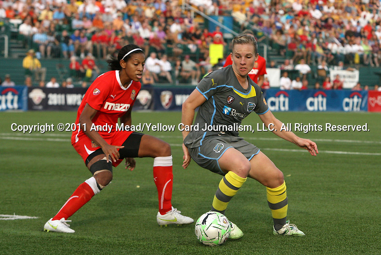 27 August 2011: Philadelphia's Amy Rodriguez (right) and Philadelphia's Kia McNeill (left). Western New York Flash defeated the Philadelphia Independence 5-4 on penalty kicks to win the final after the game ended in a 1-1 tie after overtime at Sahlen's Stadium in Rochester, New York in the Women's Professional Soccer championship game.