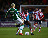 Yeovil Town's Omar Sowunmi under pressure from Lincoln City's John Akinde<br /> <br /> Photographer Andrew Vaughan/CameraSport<br /> <br /> The EFL Sky Bet League Two - Lincoln City v Yeovil Town - Friday 8th March 2019 - Sincil Bank - Lincoln<br /> <br /> World Copyright © 2019 CameraSport. All rights reserved. 43 Linden Ave. Countesthorpe. Leicester. England. LE8 5PG - Tel: +44 (0) 116 277 4147 - admin@camerasport.com - www.camerasport.com