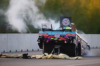 Jun 3, 2016; Epping , NH, USA; Smoke comes from the car of NHRA funny car driver Courtney Force after an engine fire during qualifying for the New England Nationals at New England Dragway. Mandatory Credit: Mark J. Rebilas-USA TODAY Sports