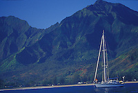 Yacht 'Heron', a Halberg-Rassy 46, at anchor with crew aboard, Mt. Waialeale in background, Hanalei Bay, Kauai